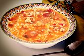 stock photo of creole  - Cajun Chicken and Sausage Gumbo in a bowl with spoon and napkin - JPG
