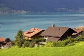 View of wooden cabins with a lake and mountain at switzerland