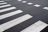 stock photo of zebra crossing  - Pedestrian crossing zebra traffic walk way on asphalt road - JPG