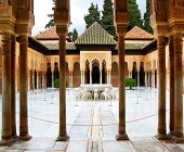 GRANADA, SPAIN - MARCH 11, 2013: Courtyard of the Lions in the Alhambra palace - masterpiece of moorish architecture (14th century)