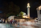 SARAJEVO, BOSNIA AND HERZEGOVINA - AUGUST 13, 2012: Ferhadija mosque and street life at night crowde