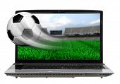 Soccer ball in motion flying off laptop screen isolated