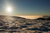 View of a sunset on winter mountain ridge