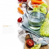 Fresh vegetables and measurement tape - diet and healthy eating concept - over white (with easy remo