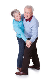 pic of waltzing  - Portrait Of Senior Couple Dancing On White Background - JPG