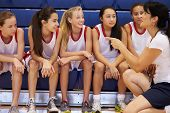 stock photo of 13 year old  - Coach Of Female High School Basketball Team Gives Team Talk - JPG