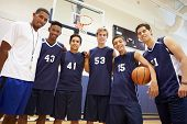 stock photo of 16 year old  - Members Of Male High School Basketball Team With Coach - JPG