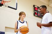 stock photo of 13 year old  - Female High School Basketball Player Talking With Coach - JPG