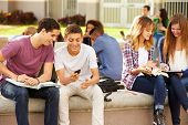 stock photo of playground school  - High School Students Hanging Out On Campus - JPG