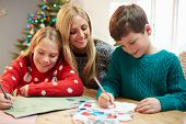 Mother And Children Writing Letter To Santa Together