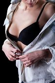 pic of take off clothes  - Woman takes off her shirt and shows her bra - JPG