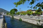 FETHIYE, TURKEY - APRIL 1, 2014: People and car traffic on the banks of river along the Ataturk Aven