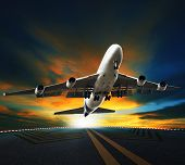 stock photo of air transport  - passenger plane take off from runways against beautiful dusky sky with copy space use for air transport journey and traveling industry business - JPG