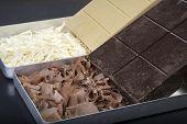 foto of shivering  - Dark and milk chocolate shavings ready to decorate cake    - JPG