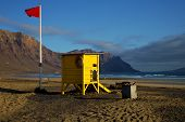 Lifeguard Chair Red Flag In Spain   Pond  Coastline And Summer