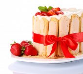 Tasty cake Charlotte with fresh strawberries, isolated on white