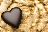 stock photo of mink  - Large dark brown heart on genuine mink blanket - JPG