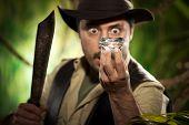 Explorer Finding A Huge Gem In The Jungle