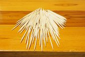 Several Toothpicks On A Wooden Table