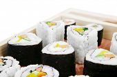 Japanese Cuisine - Maki Roll with Deep Fried Vegetables inside . on wooden plate . isolated over whi