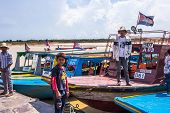 Siem Reap, Cambodia - May 3: Cambodian Men Wait The Tourist For Visiting Tonle Sap Lake In Siem Reap