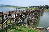 Постер, плакат: The Old Wooden Bridge Bridge Across The River Or Mon Bridge At Sangklaburi Kanchanaburi Thailand
