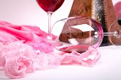 Two Glasses Of Red Wine On A White Background Of About Pink Panties And T-shirts