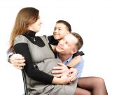 Happy Family Hugging Isolated On White