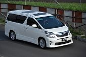 white colored toyota vellfire
