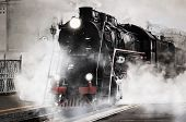 picture of steam  - Retro steam train stands on the railway station - JPG