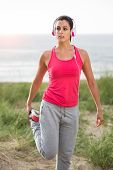 Woman On Summer Fitness Workout Stretching Leg