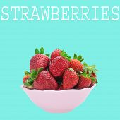 a pink bowl with appetizing strawberries and the word strawberries on a blue background