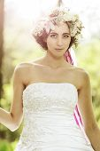Beautiful bride with flower tiara at the tree