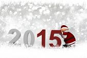 Christmas and New Year background with Santa pushing the numbers 2015