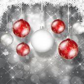 Christmas background with bokeh lights and hanging baubles