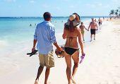 Romantic loving couple walking on the beach. Caribbean vacation.