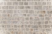Gray brick background, grunge style brickwork wall, stylish modern architecture detail, building exterior, stonewall texture