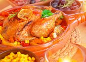 Closeup photo of tasty baked Thanksgiving turkey with fresh green parsley, delicious traditional food for autumn holiday, healthy eating concept