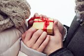 Close-up of a little gift box in hands of lovers