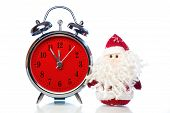 pic of father time  - Santa Claus or Father Frost and vintage alarm clock with red dial on white background with reflection - JPG