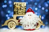 Santa Claus And Old Retro Wooden Car With Gift Box