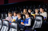 Shocked families watching movie in cinema theater