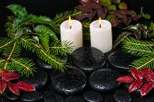 Winter Spa Concept Of Zen Basalt Stones With Drops, Candles And Evergreen Branches, Closeup