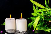 Spa Setting Of Zen Basalt Stones With Drops, White Candles, Beads And Bamboo, Closeup