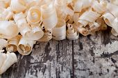 Wood shavings o0n a wooden background