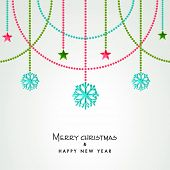 Beautiful greeting card for Merry Christmas and Happy New Year celebrations with hanging snowflakes and stars on shiny background.