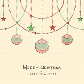 Merry Christmas and Happy New Year celebration concept with stylish hanging X-mas balls and stars on beige background.