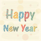 Stylish and colorful text on beige background for Happy New Year celebrations.