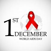 1st December, World Aids Day concept with glossy red ribbon of Aids awareness on globe.