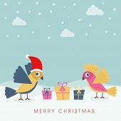 Beautiful couple of love birds in Santa hat with gift boxes on winter background for Merry Christmas celebrations.